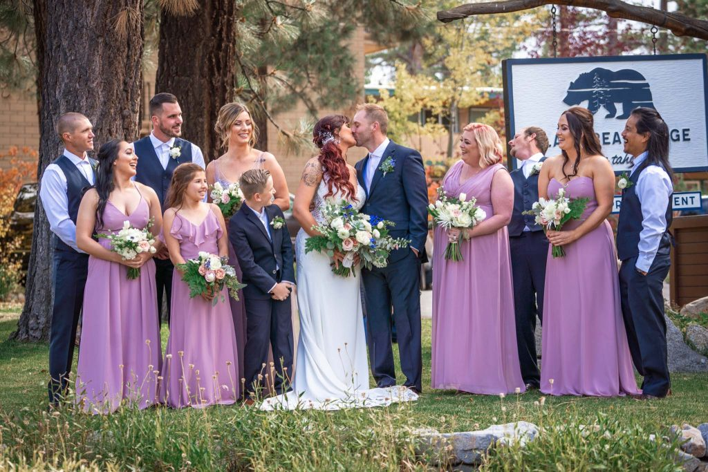 Wedding party in front of Black Bear Lodge sign in South Lake Tahoe