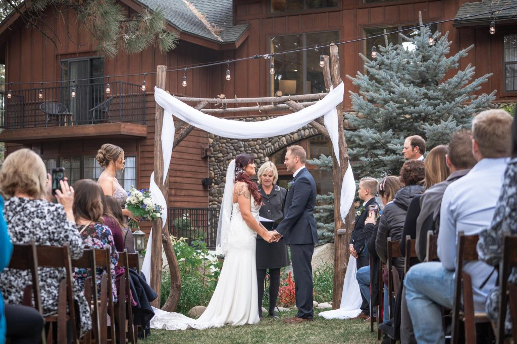 Saying vows in front of the arch at Black Bear Lodge