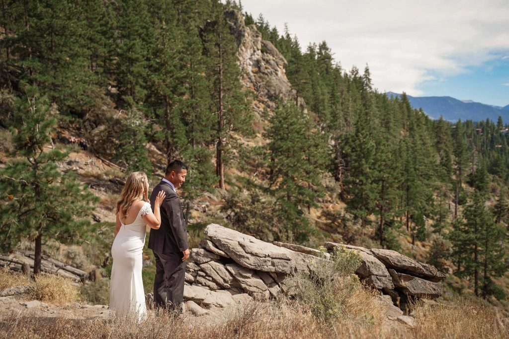 Bride and groom for their first look at Cave Rock, South Lake Tahoe