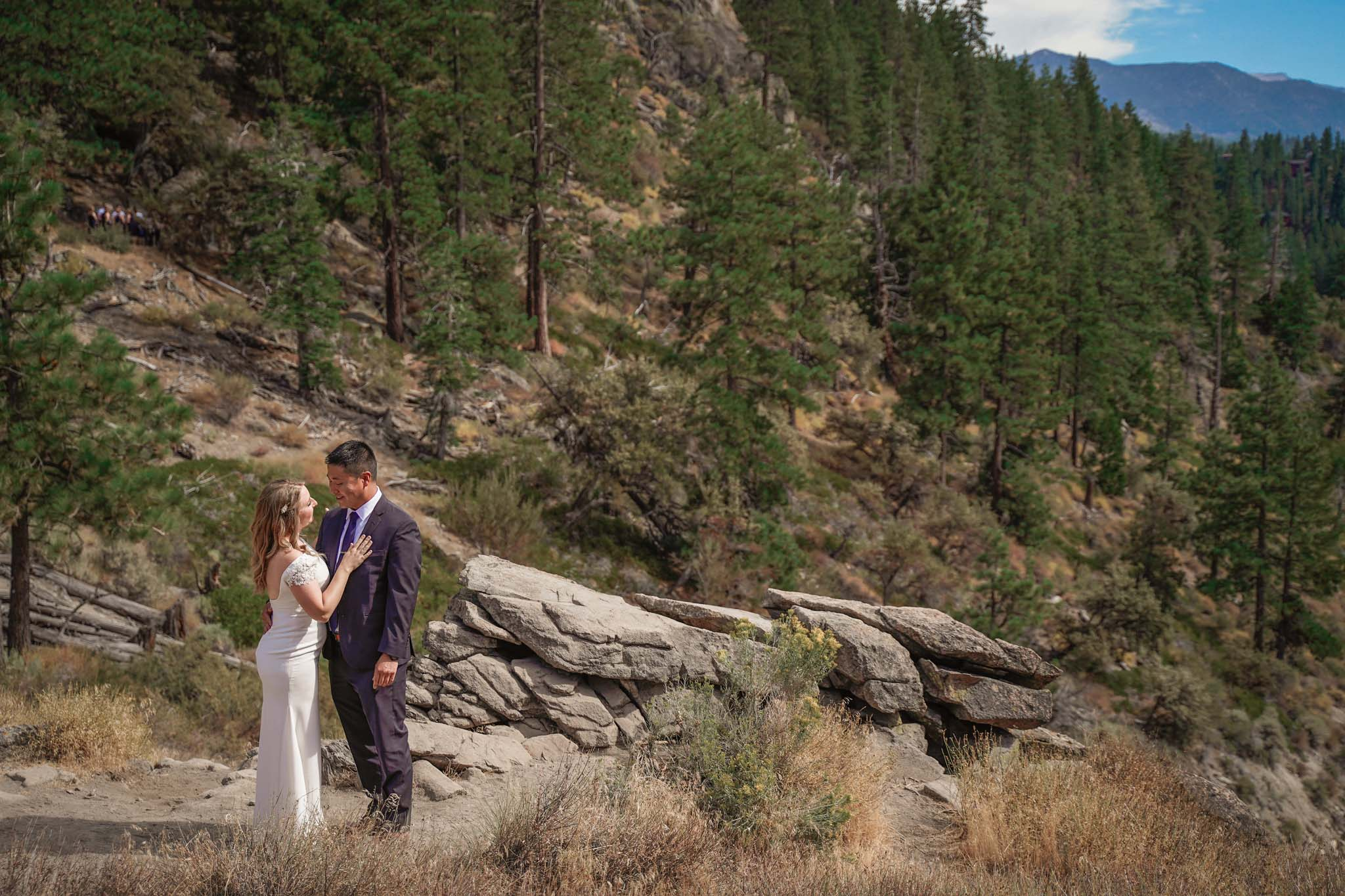 Bride and groom sharing a moment for their first look at Cave Rock, South Lake Tahoe