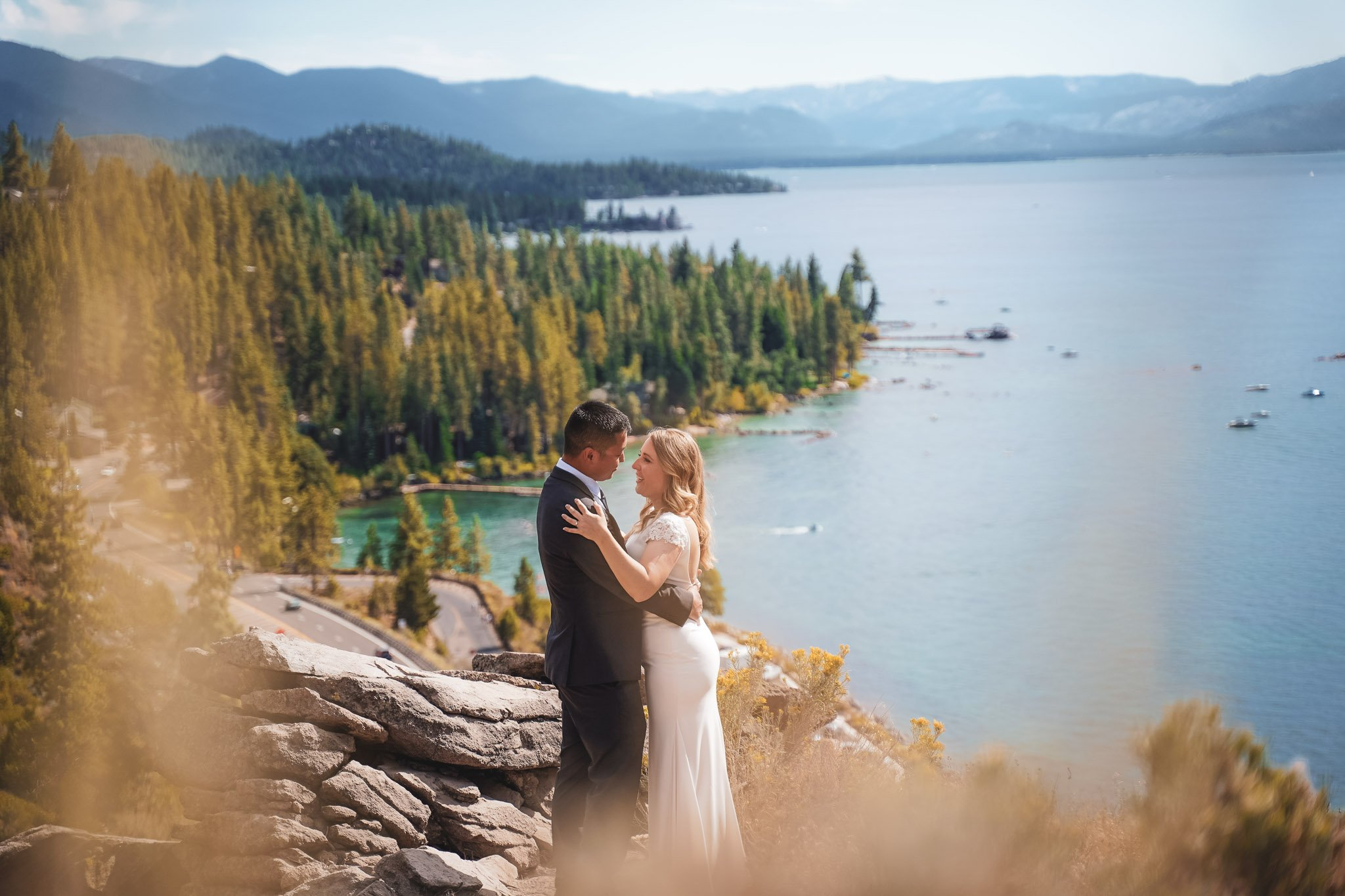 Bride and groom dancing with Lake Tahoe as a backdrop with mountains and lake