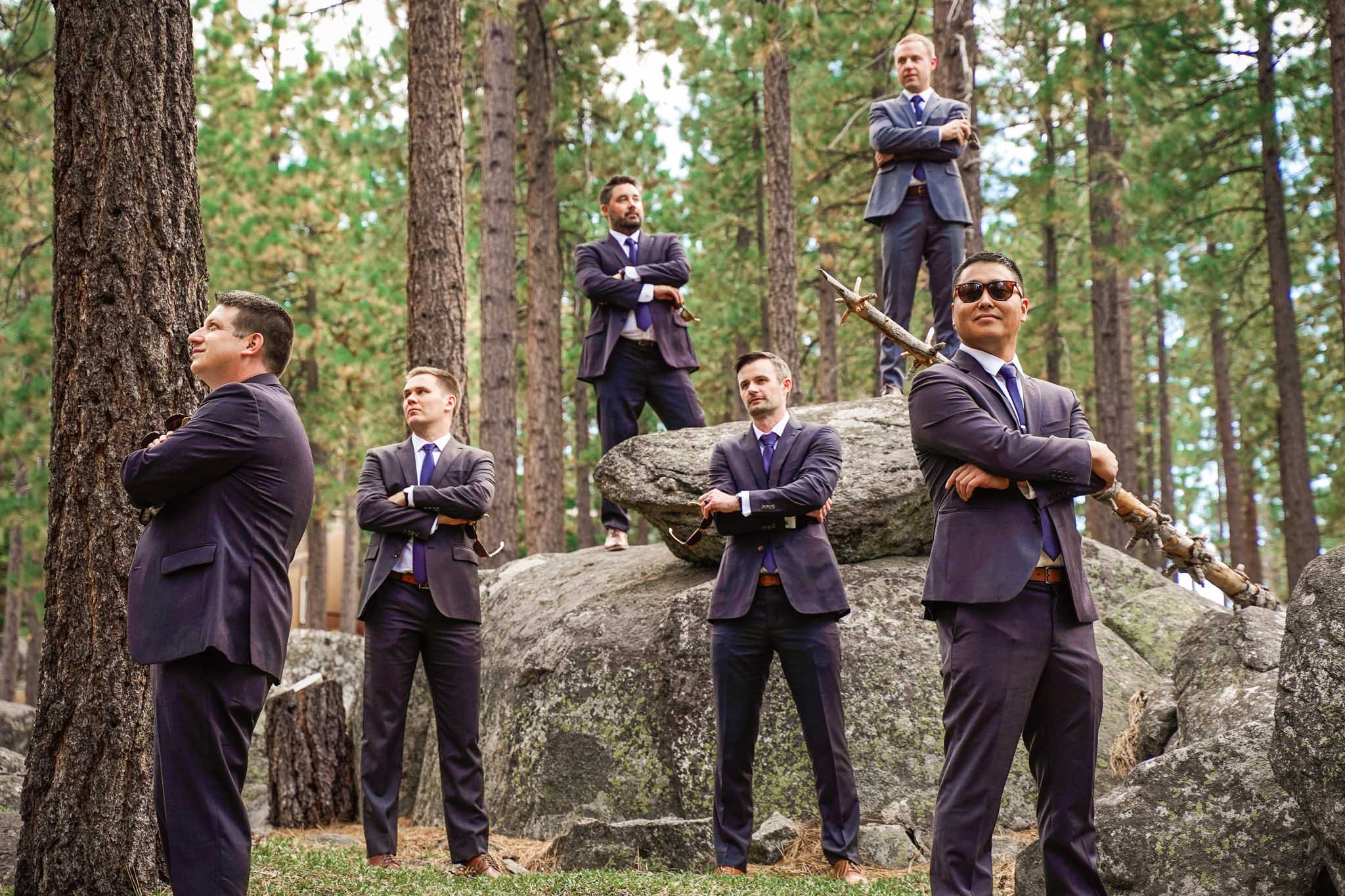Groom and groomsmen pose in front of a forest of pines in South Lake Tahoe