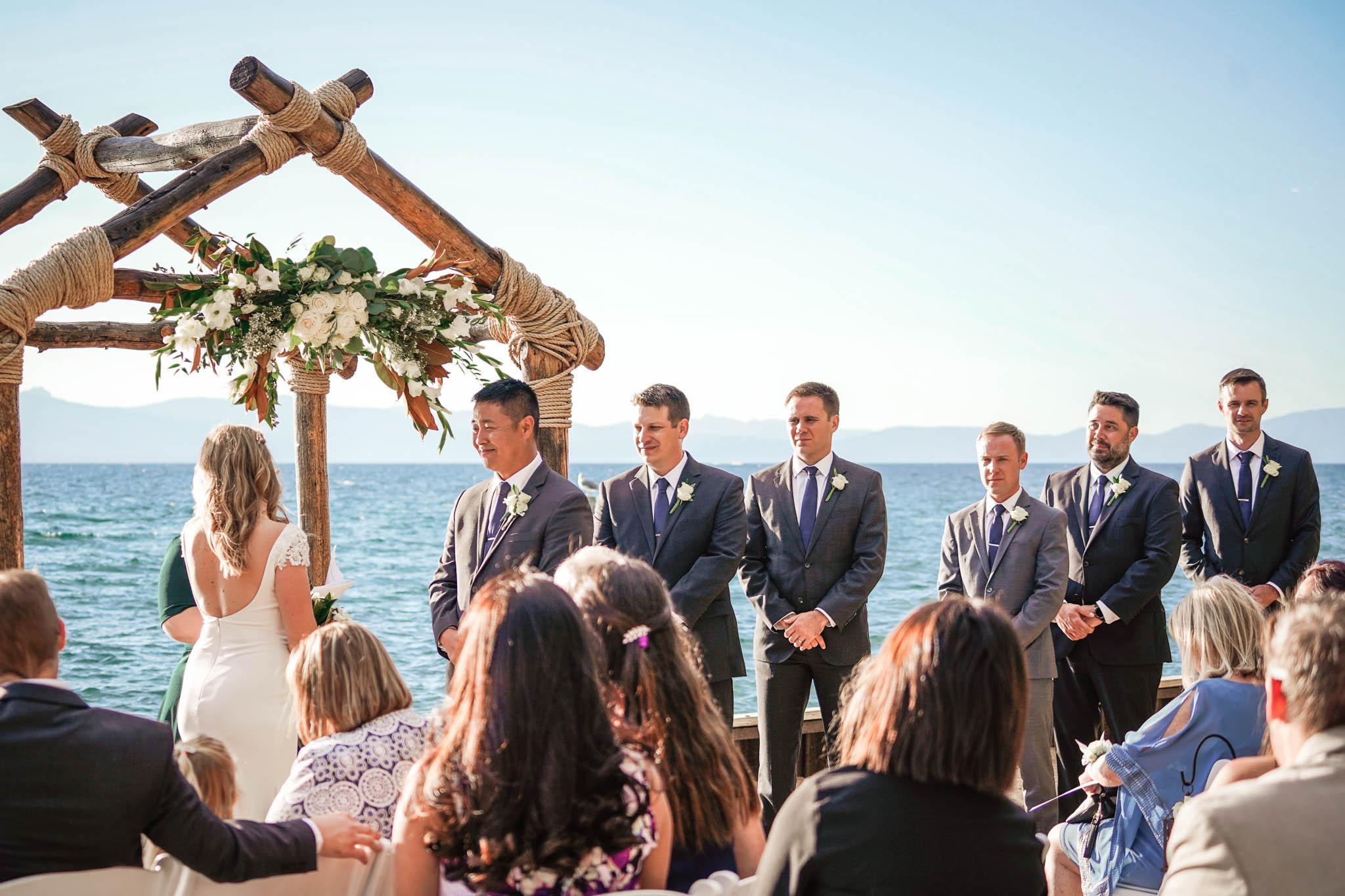 Groomsmen during wedding at Lakeside Beach in South Lake Tahoe