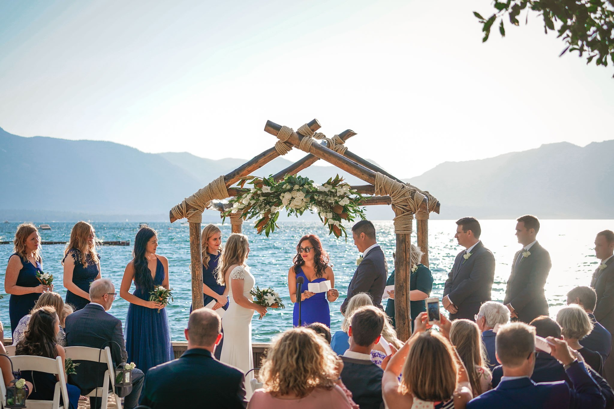 Wedding party during wedding at Lakeside Beach in South Lake Tahoe