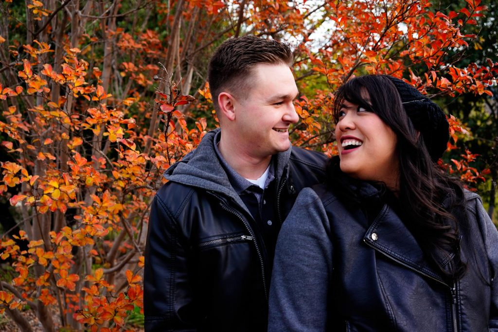 Engagement photography session with orange leaves during autumn in Lake Tahoe