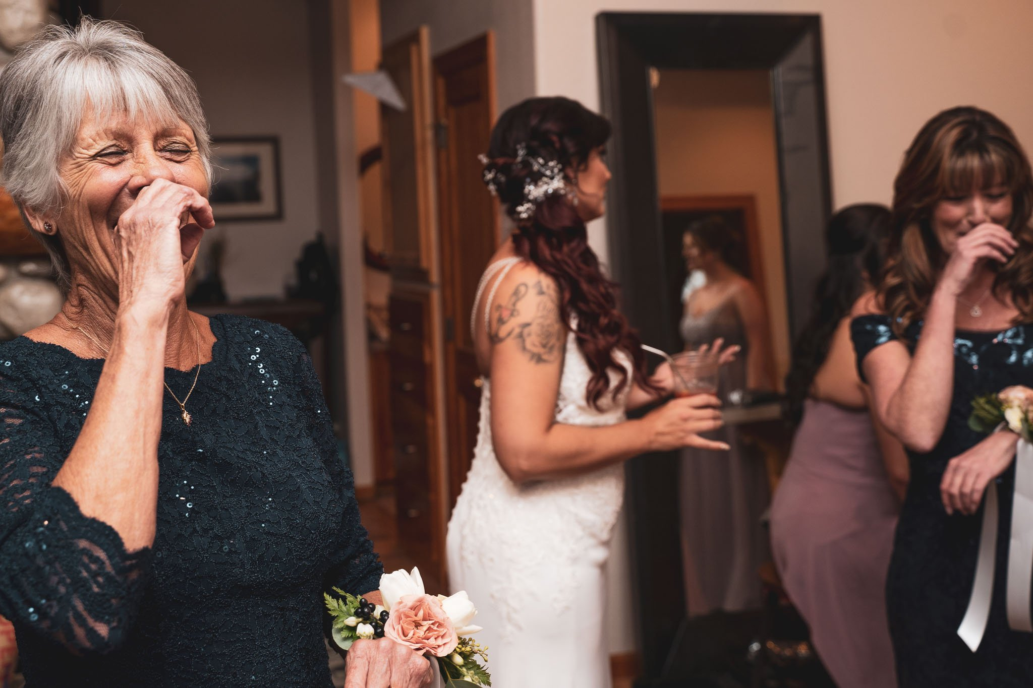 Bride's grandmother and mother both laugh in the same way