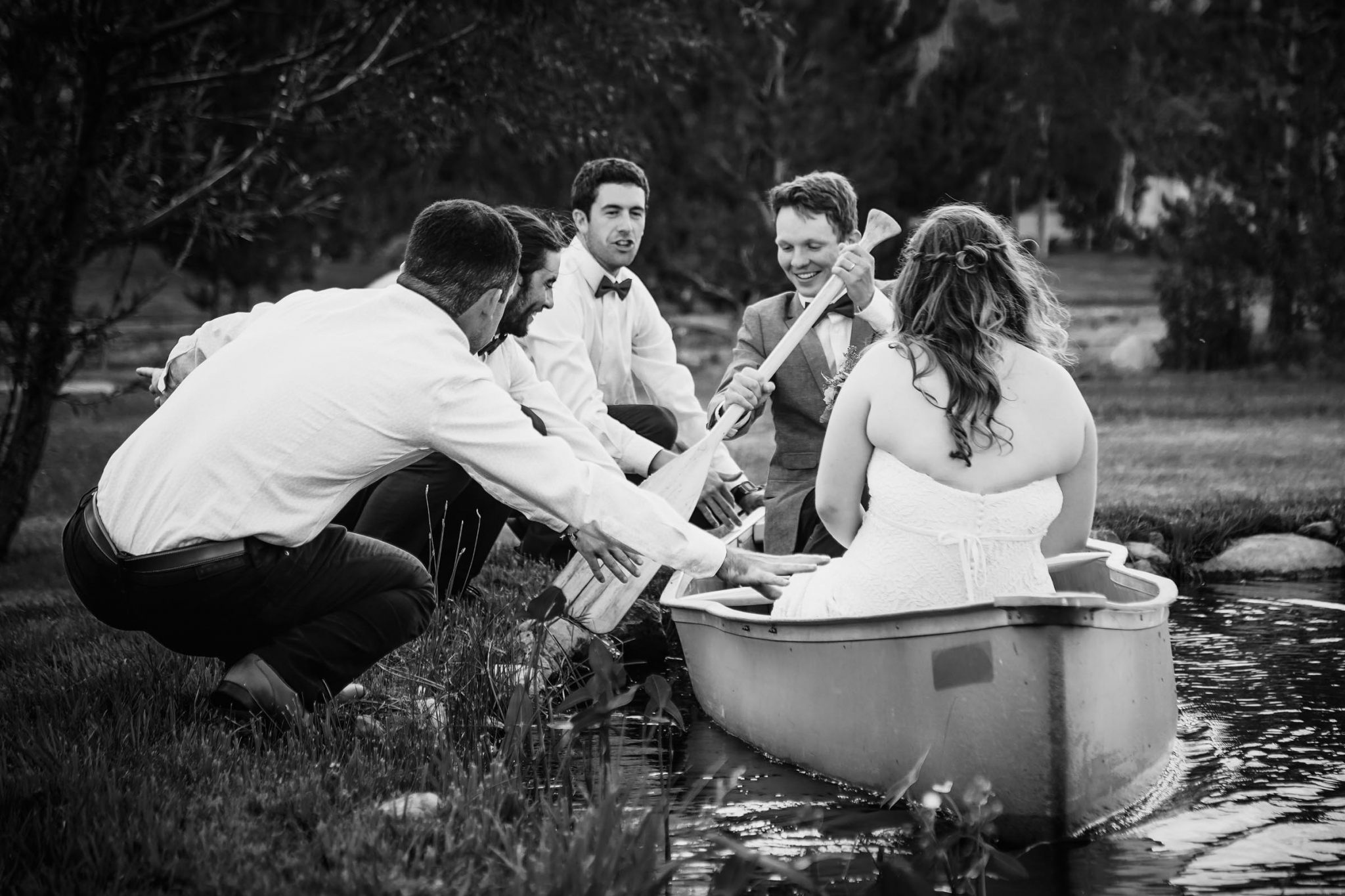 Gardnerville wedding exit on a canoe with the help of groomsmen