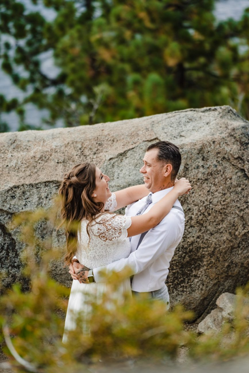 Bride and groom laughing during wedding photography session surrounded by aspen in South Lake Tahoe