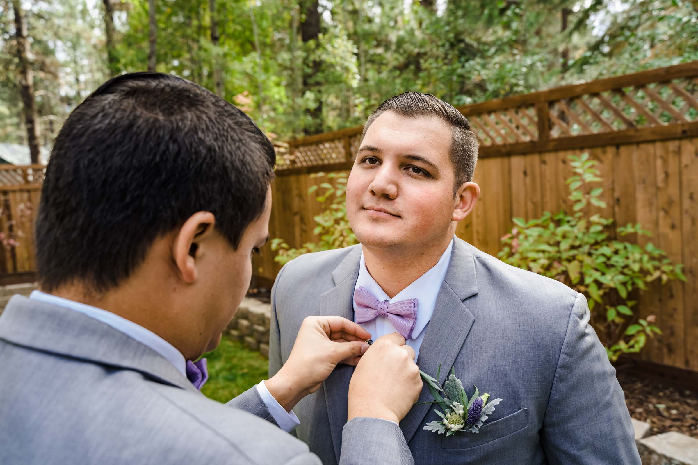 Groom getting ready for small intimate wedding in South Lake Tahoe
