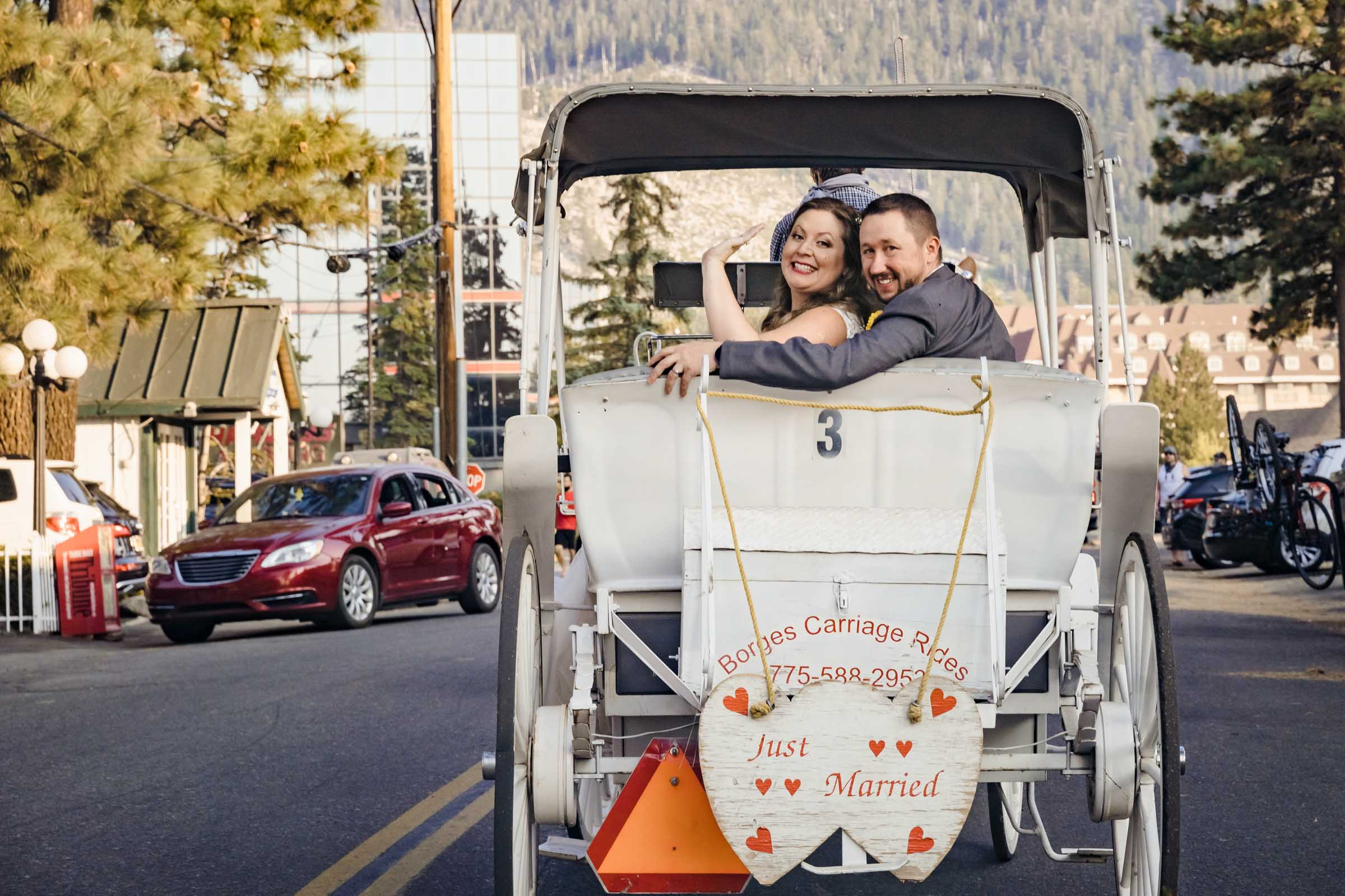 Newlywed carriage taking them to the reception at Basecamp Hotel